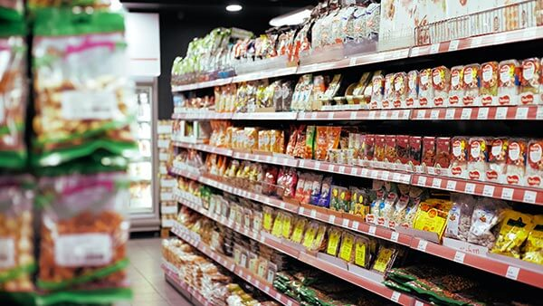 aisle of grocery store full of consumer goods